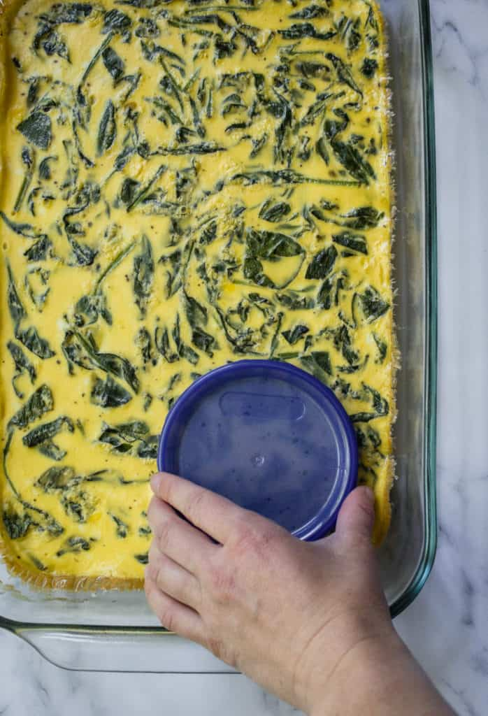 eggs and spinach baked and using a lid to cut circles