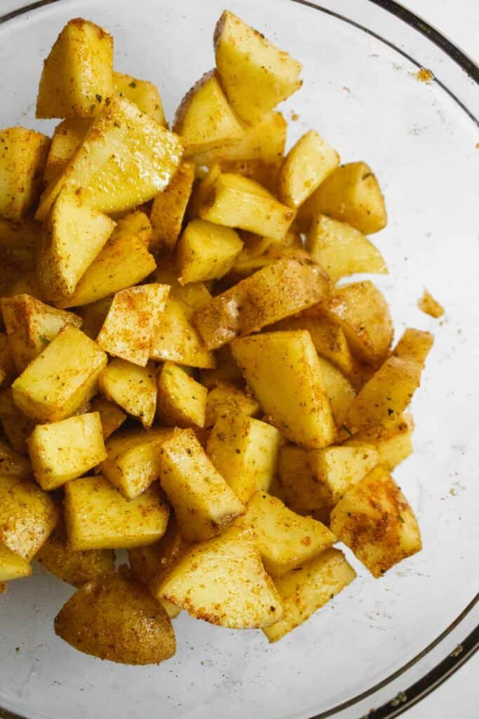 tossed potatoes with oil and spices