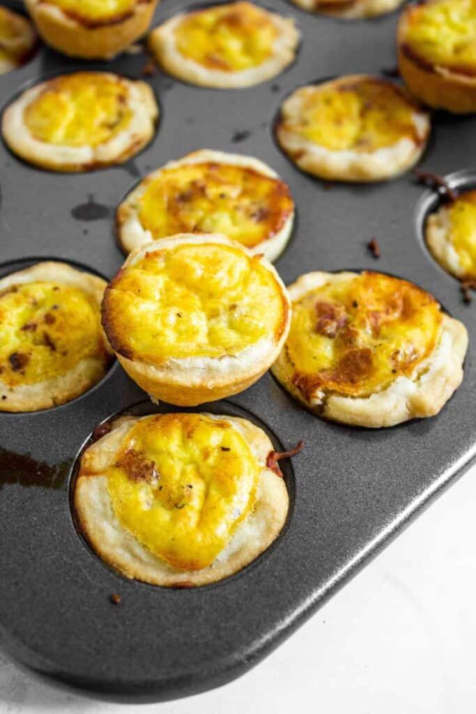 close up shot of mini quiche in muffin tin