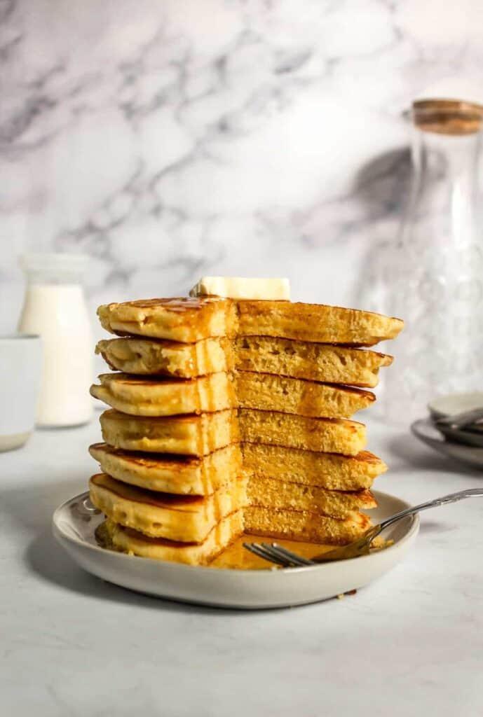 Stack of cornmeal pancakes cut open