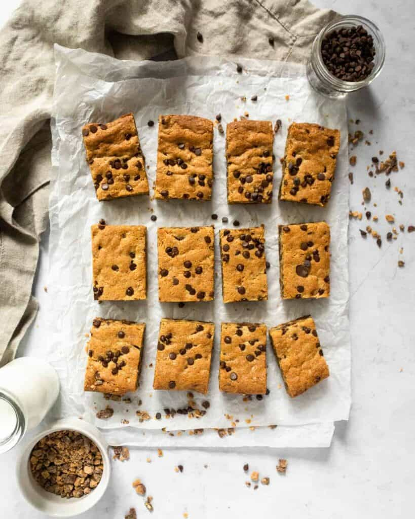 toffee chocolate chip cookie bars with toffee bits sprinkled around them