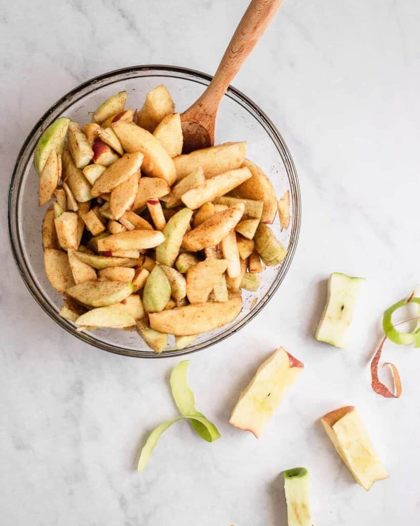 sliced apples tossed in a large bowl