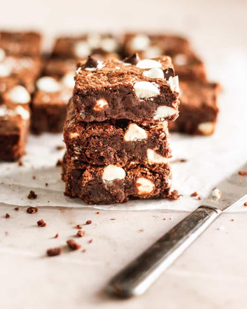 stack of 3 sliced triple chocolate brownies