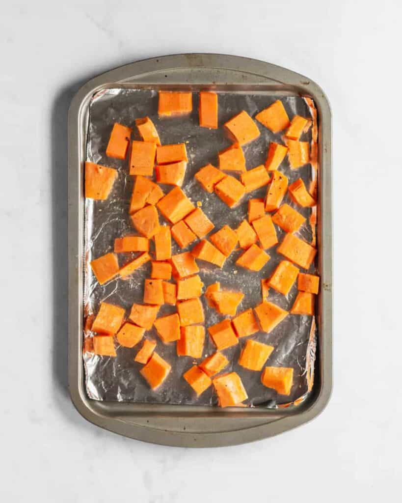 baking sheet of cubed sweet potatoes
