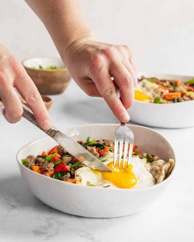 sweet potato breakfast bowl being cut into