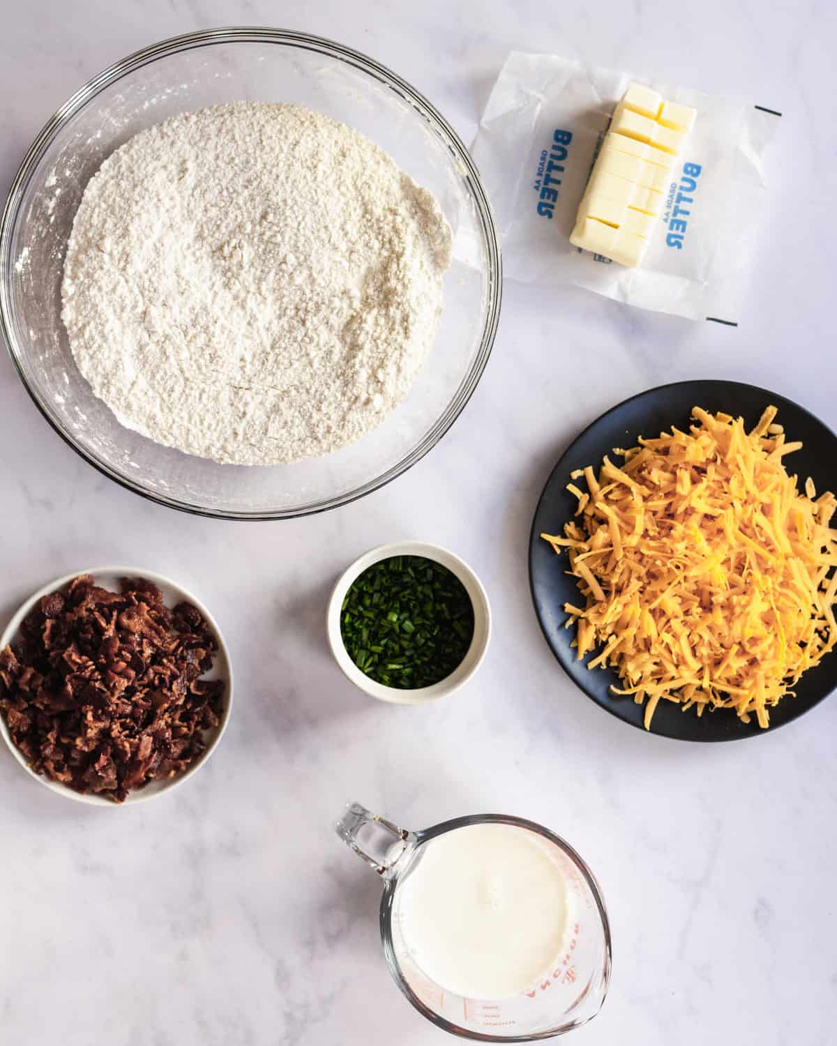ingredients needed for cheddar bacon chive scones.