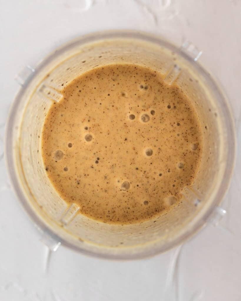 overhead shot looking into blender after ingredients have been blended together.
