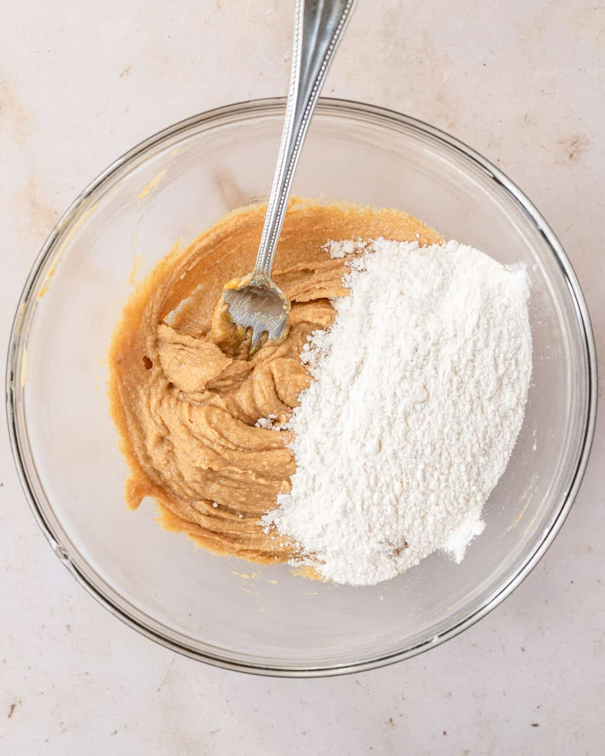 wet ingredients with the flour mixture poured on top.
