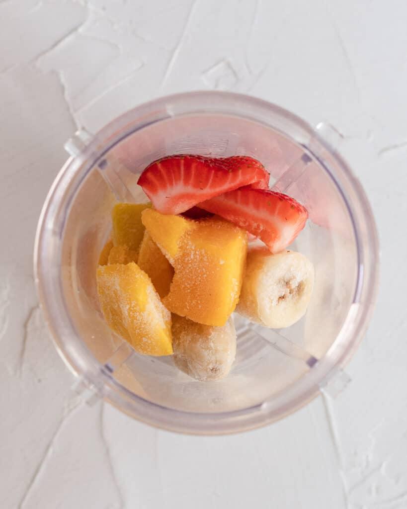 frozen fruit sitting in the blender