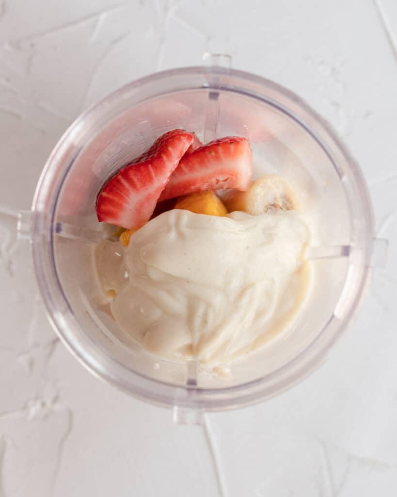 fruit in blender plus yogurt and milk