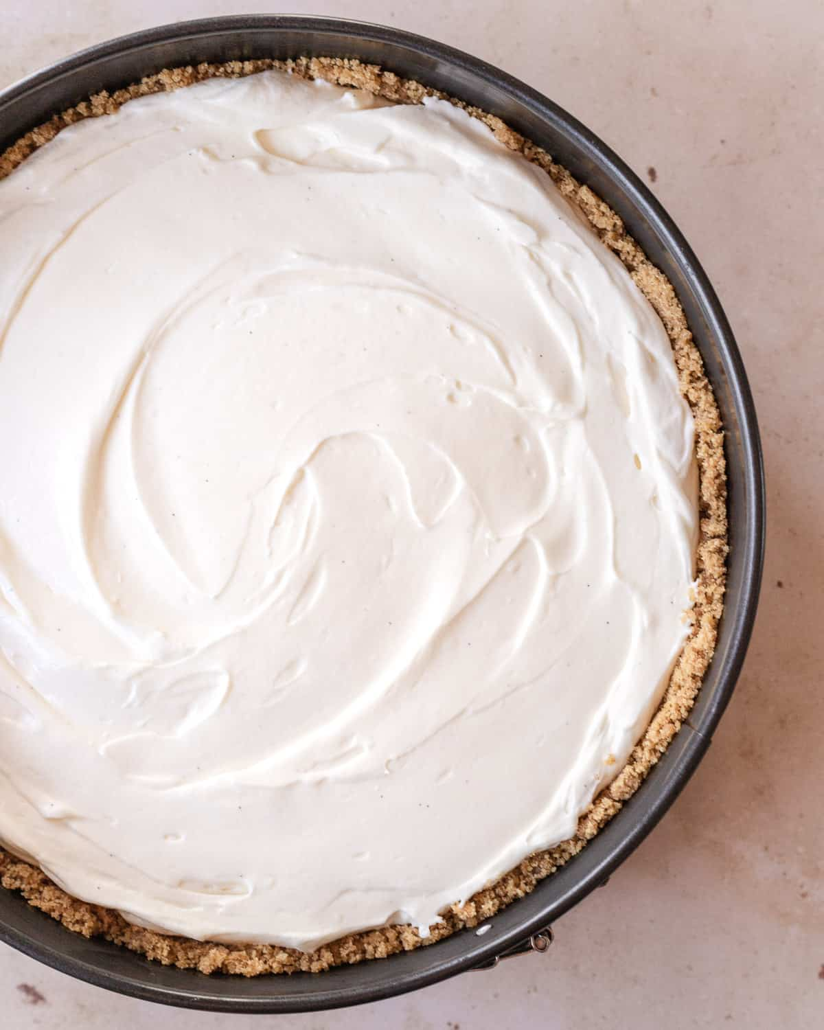 overhead shot of cheesecake filling in the crust in the pan